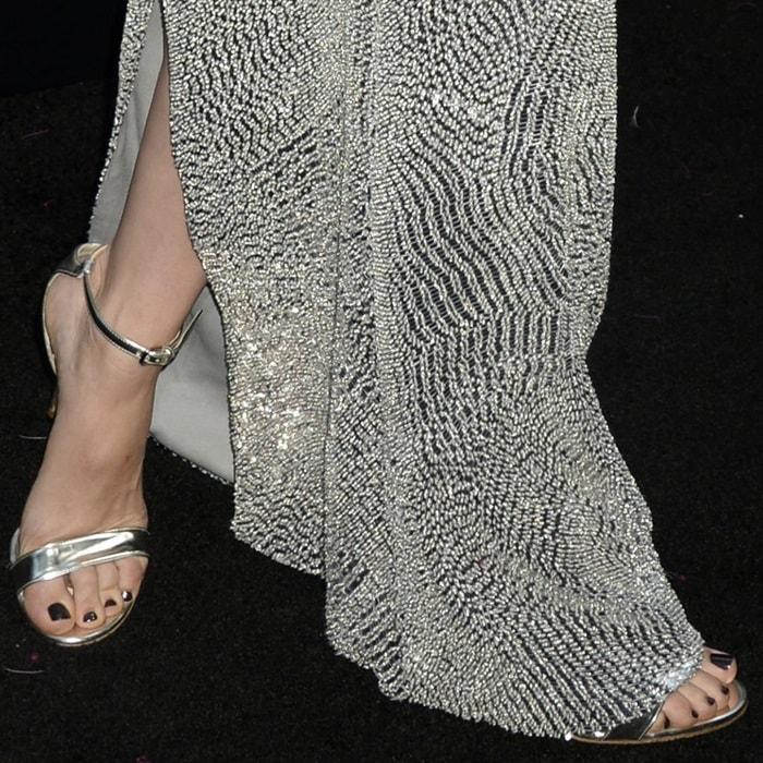 Scarlett Johansson showing off her pedicured toes in metallic sandals
