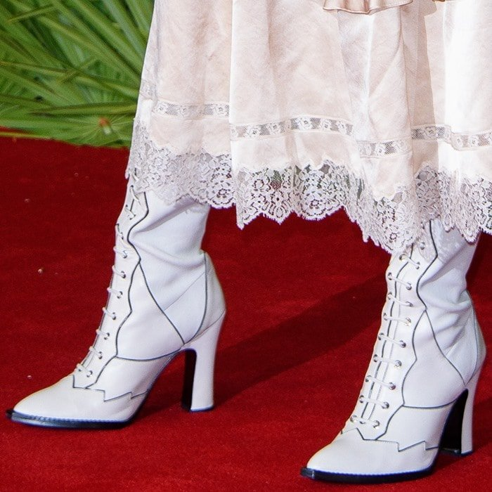 Selena Gomez rocking white Western-inspired boots