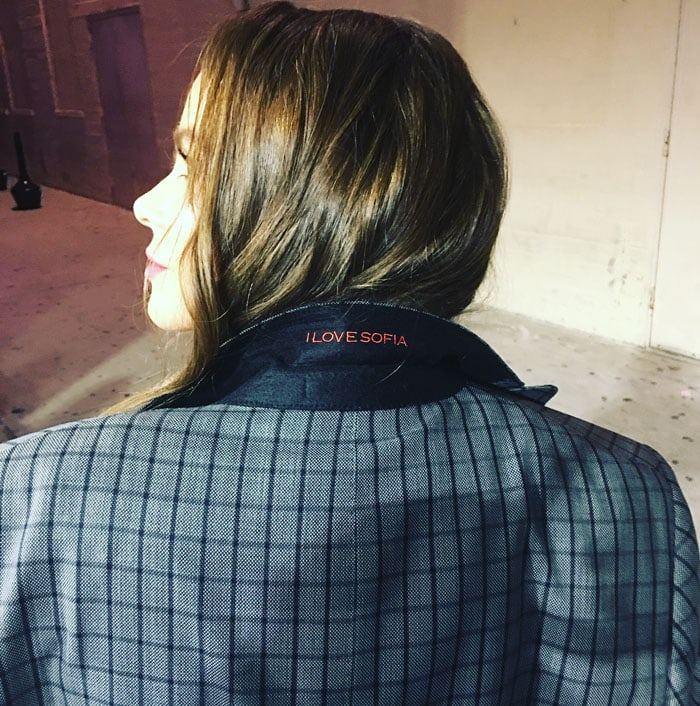 """The actress proudly shows off her husband's suit with the words """"I Love Sofia"""" monogrammed on the collar"""