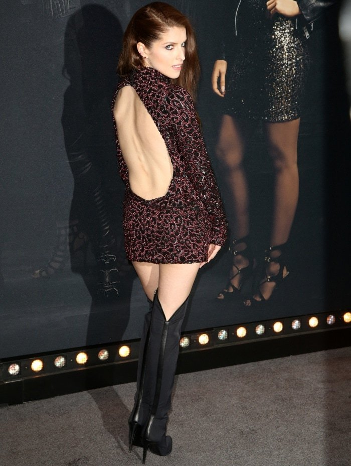 Anna Kendrick's burgundy-and-black dress features a sexy open back