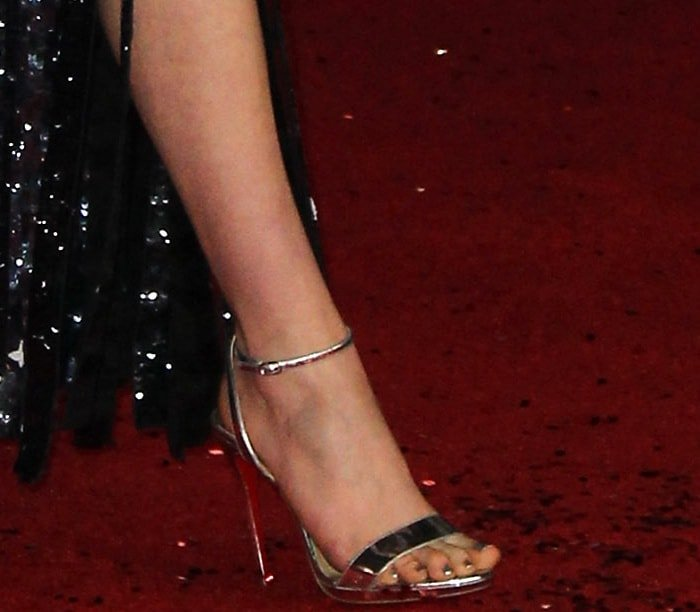 Daisy Ridley showing off her feet in streamlined Jonatina sandals from Christian Louboutin