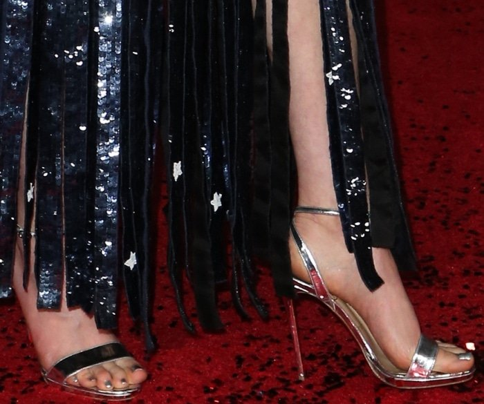 "Daisy Ridley wearing Christian Louboutin ""Jonatina"" metallic silver sandals at the ""Star Wars: The Last Jedi"" premiere"