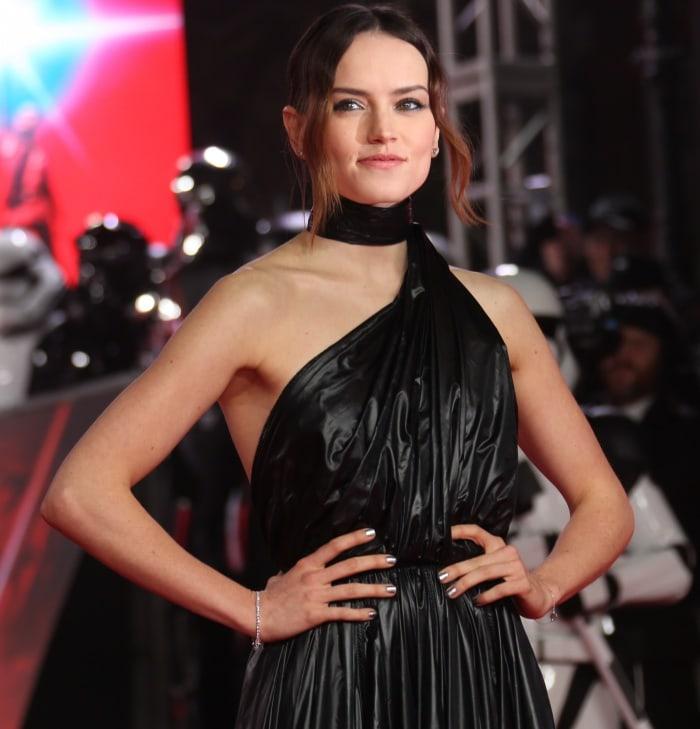 "Daisy Ridley wearing a Calvin Klein 205W39NYC black nylon dress at the ""Star Wars: The Last Jedi"" UK premiere"