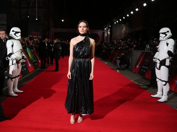 """Daisy Ridley wearing a Calvin Klein 205W39NYC black nylon dress and custom Christian Louboutin """"Rey"""" sandals at the """"Star Wars: The Last Jedi"""" UK premiere"""