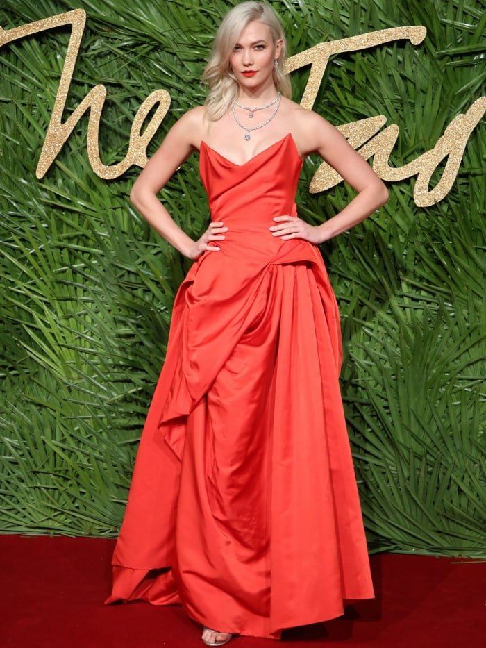 Karlie Klossturned heads in a red Vivienne Westwood Couture gown