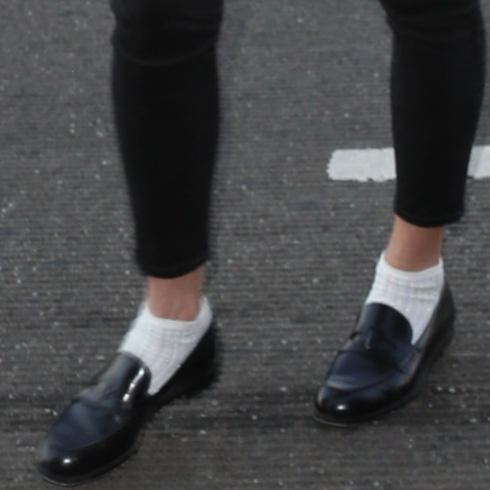 Karlie Kloss wearing black loafers with white socks