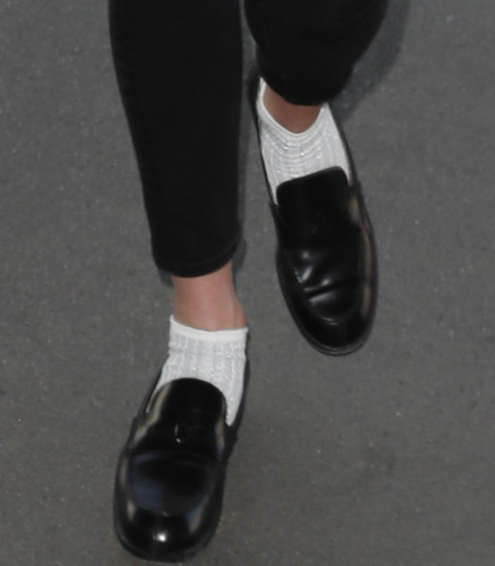 Karlie Kloss wearing Christian Louboutin Montezumo Donna loafers with white socks