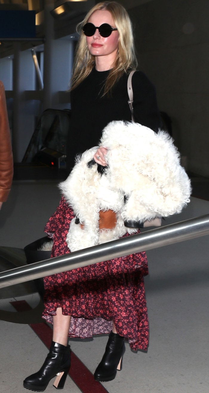 """Kate Bosworth wearing a Naked Cashmere """"Campbell"""" sweater, an Ulla Johnson """"Maria"""" ruffled printed maxi skirt, and Nicholas Kirkwood """"Annabel"""" boots at LAX"""