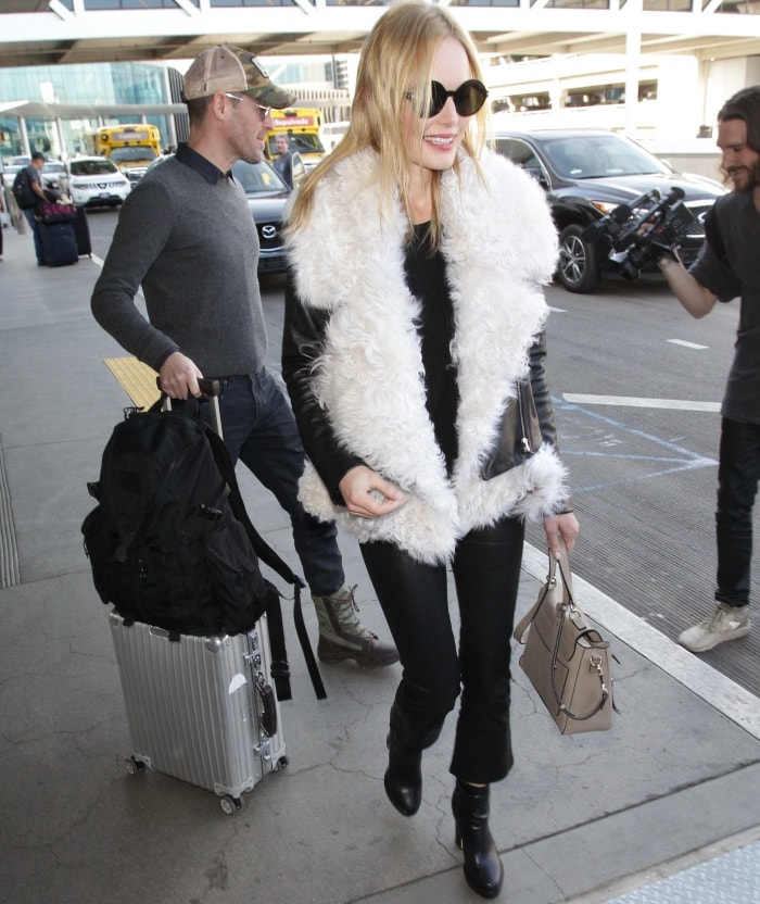 """Kate Bosworth wearing a black leather jacket, J Brand """"Maria"""" leather pants, and Nichols Kirkwood """"Annabel"""" boots at LAX"""