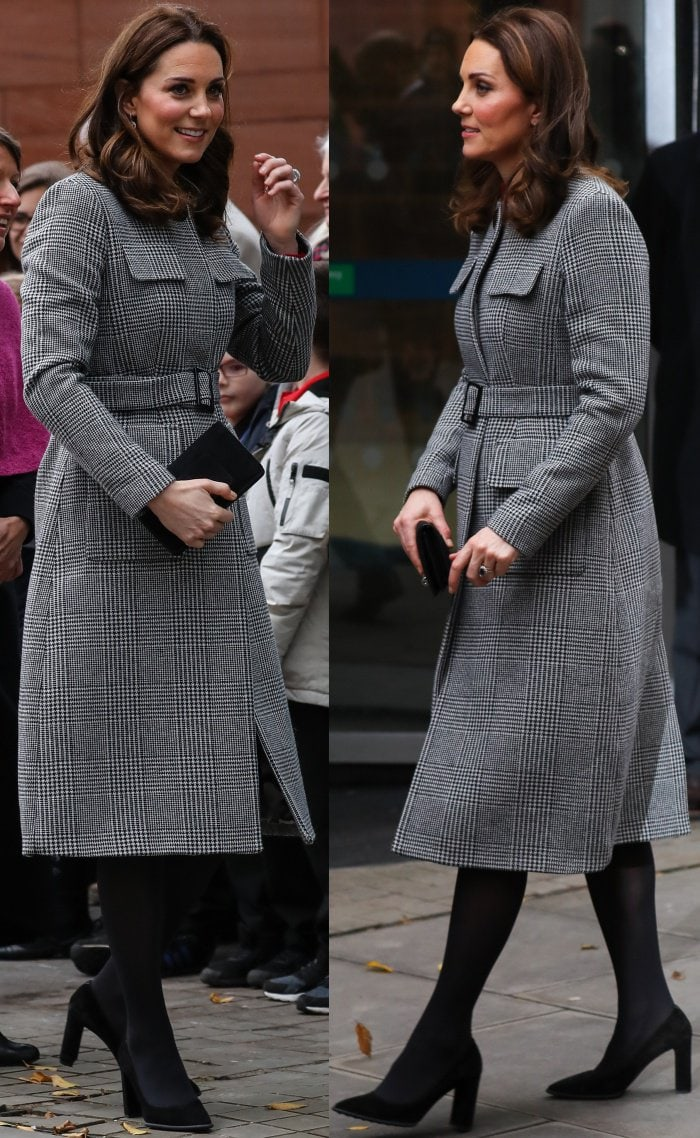 "Kate Middleton wearing the L.K. Bennett ""Delli"" coat, Goat ""Elodie"" dress, and Tod's black suede pumps during the Children's Global Media Summit in Manchester"