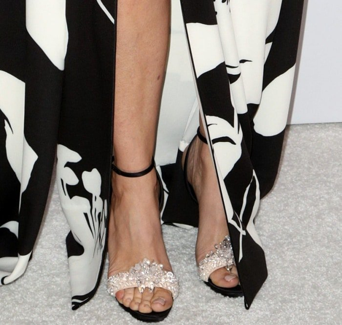 """Kristen Wiig wearing Christian Louboutin black ankle-strap sandals with embellished toe bands at the """"Downsizing"""" special screening in Los Angeles"""