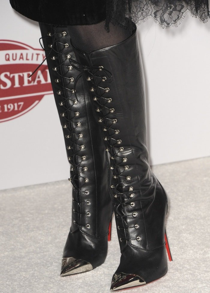 """Laura Dern wearing Christian Louboutin lace-up knee-high boots at the """"Downsizing"""" special screening in Los Angeles"""