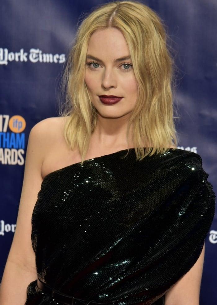Margot Robbie wearing a Saint Laurent one-shoulder dress at the 2017 Gotham Independent Film Awards