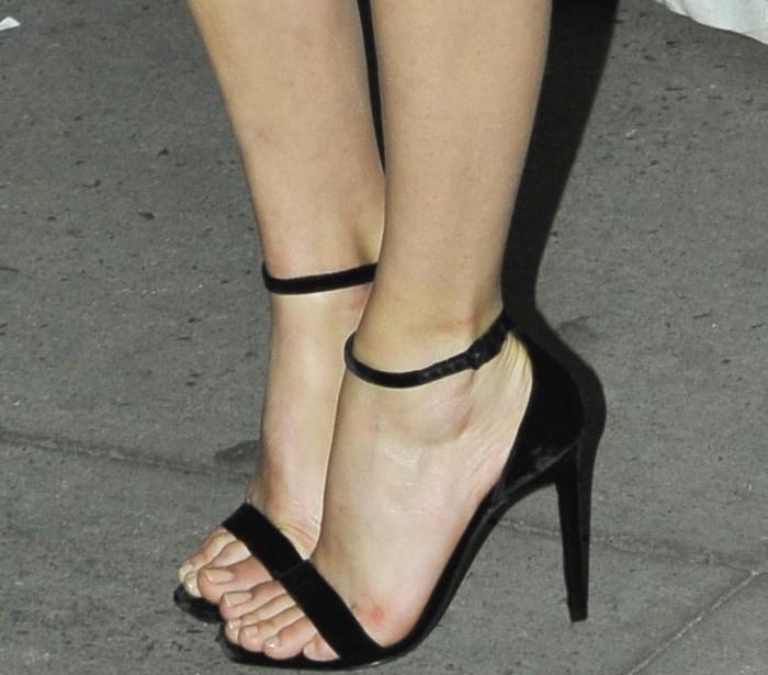 "Margot Robbie wearing Saint Laurent ""Amber"" black velvet sandals at the 2017 Gotham Independent Film Awards"