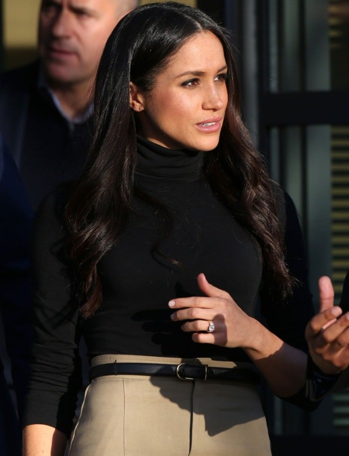 Meghan Markle wearing a Wolford turtleneck and a Joseph midi skirt during the Terrence Higgins Trust World AIDS Day event