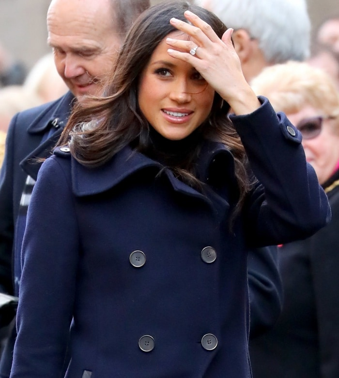 Meghan Markle wearing a Mackage double-breasted military coat during the Terrence Higgins Trust World AIDS Day event