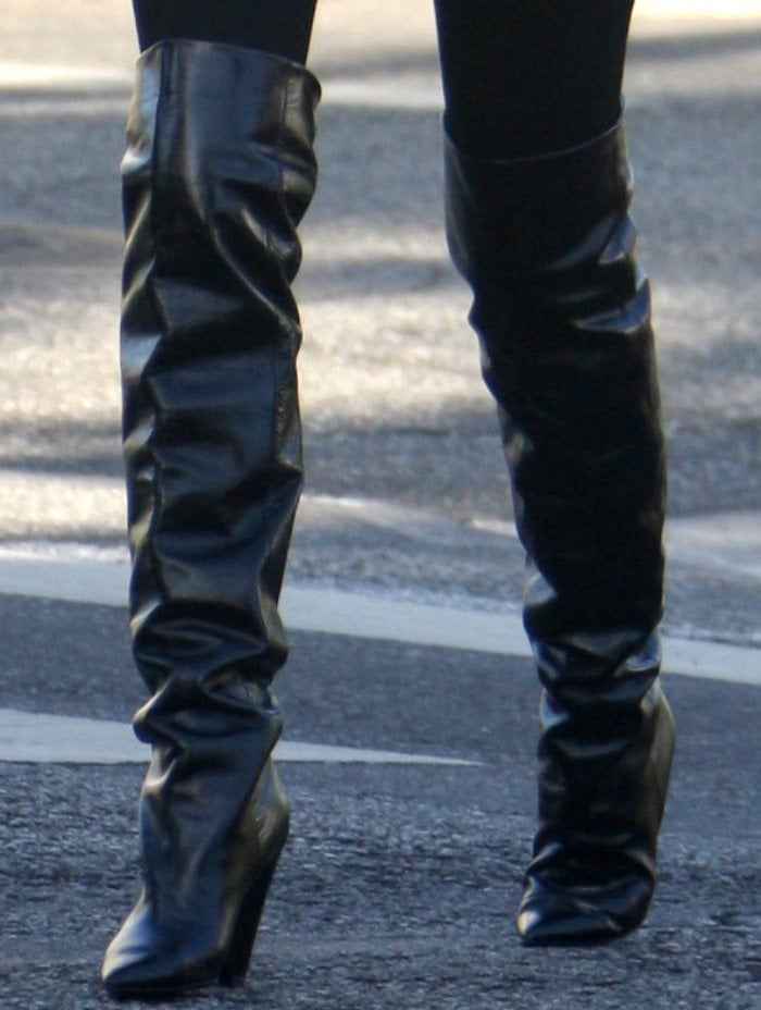 "Olivia Culpo wearing Saint Laurent ""Niki"" glossed-leather knee boots"