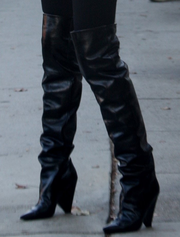 "Olivia Culpo wearing Saint Laurent ""Niki"" glossed-leather knee boots while out and about in Los Angeles"