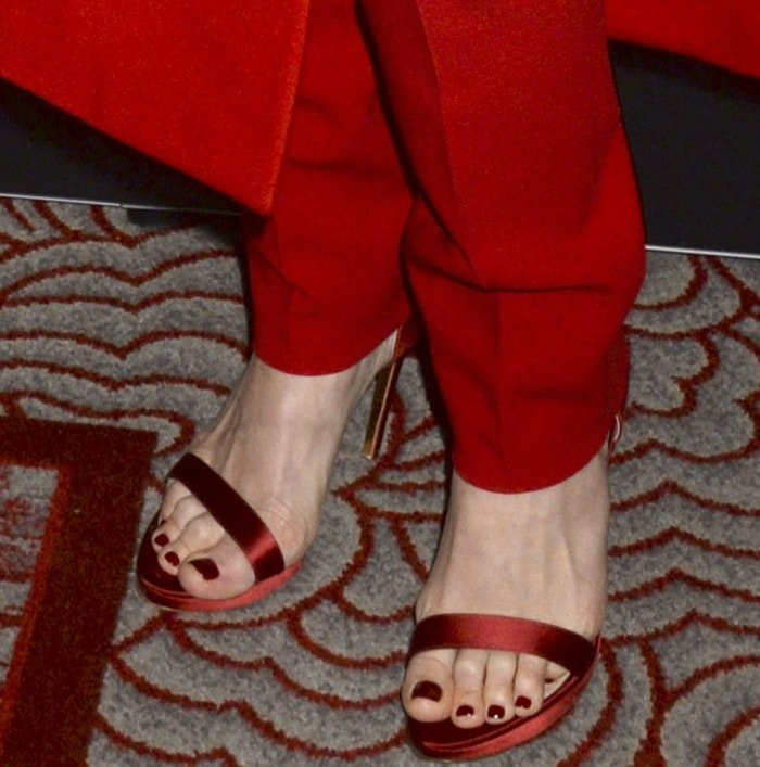"""Rebecca Ferguson wearing Rupert Sanderson red satin sandals at the world premiere of """"The Greatest Showman"""" in New York City"""