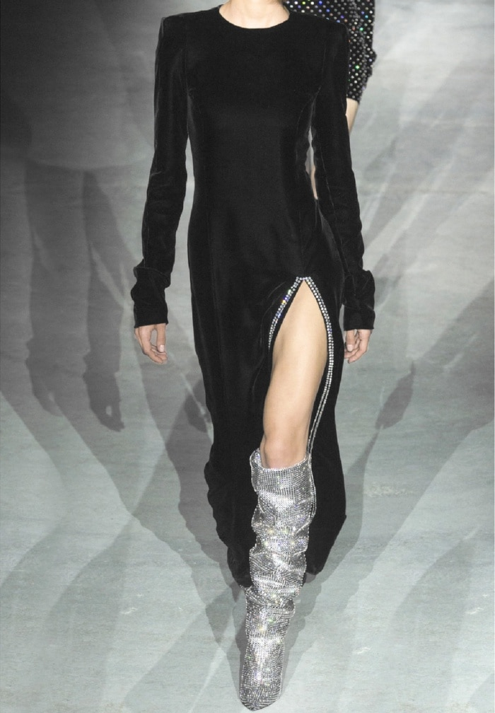 "Model wearing Saint Laurent's ""Niki"" crystal-embellished over-the-knee boots"