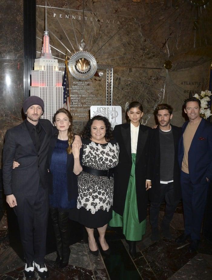 "(L-R) Michael Gracey, Rebecca Ferguson, Keala Settle, Zendaya, Zac Efron, and Hugh Jackman attend the cast of ""The Greatest Showman"" light the Empire State Building"