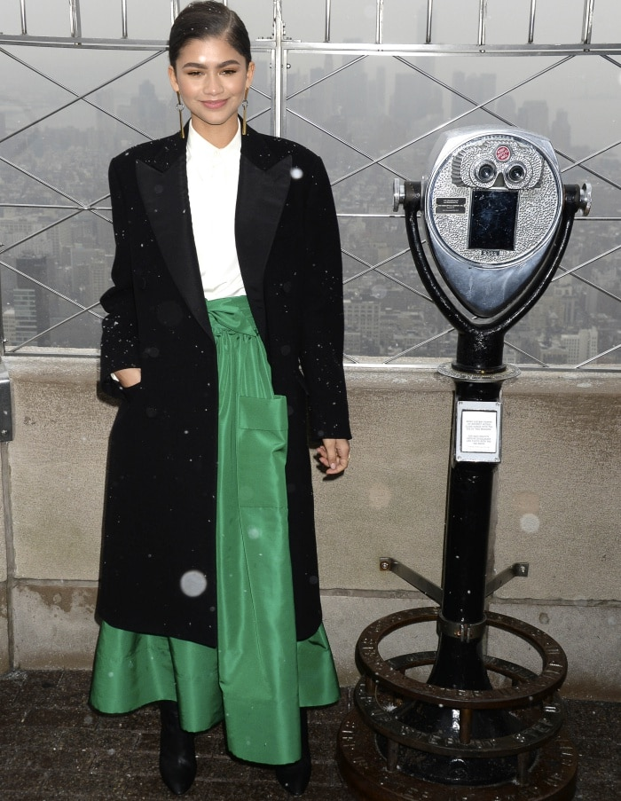Zendaya styled her black Ralph Lauren double-breasted coat with a green Martin Grant skirt