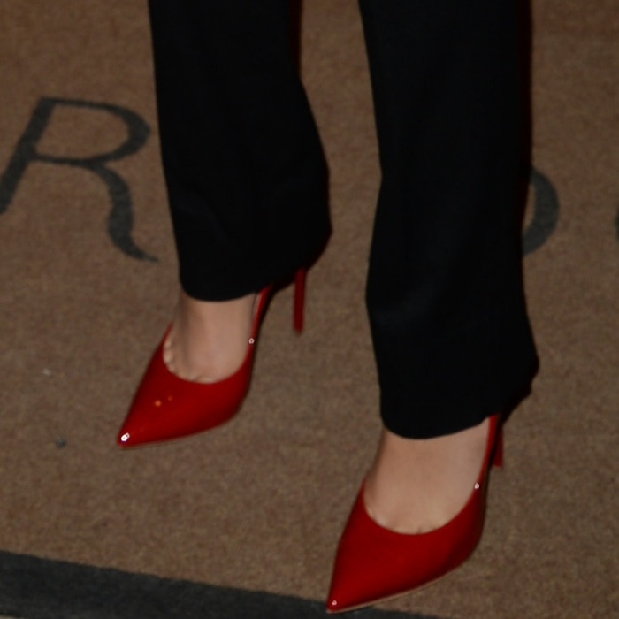 Zendaya wearing Casadei red patent pumps at London's Vogue House