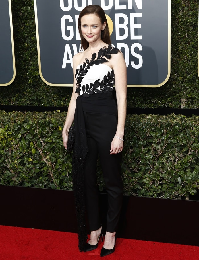 Alexis Bledel wearing a one-shoulder jumpsuit from the Oscar de La Renta Resort 2018 collection at the 2018 Golden Globe Awards held at the Beverly Hilton Hotel in Beverly Hills, California, on January 7, 2018