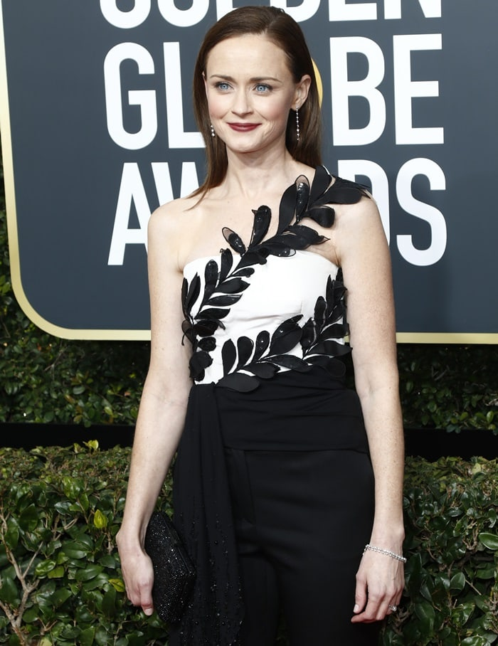 Alexis Bledel wearing a white top featuring applique leaf-like design