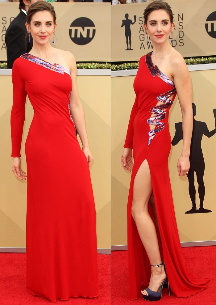 Alison Brie in an interesting dress by Dundas, which married a sequined strip with beautiful red fabric