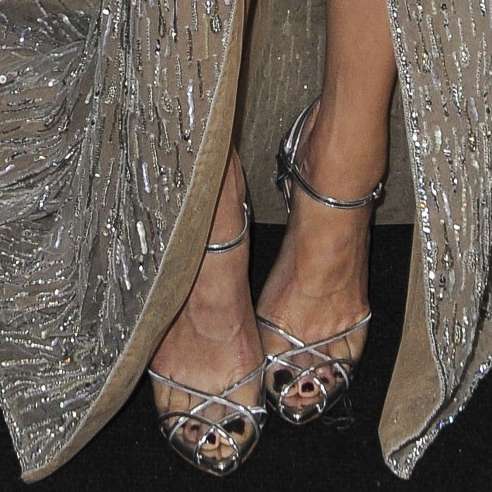 Amber Heard showing off her feet in matching metallic PVC sandals