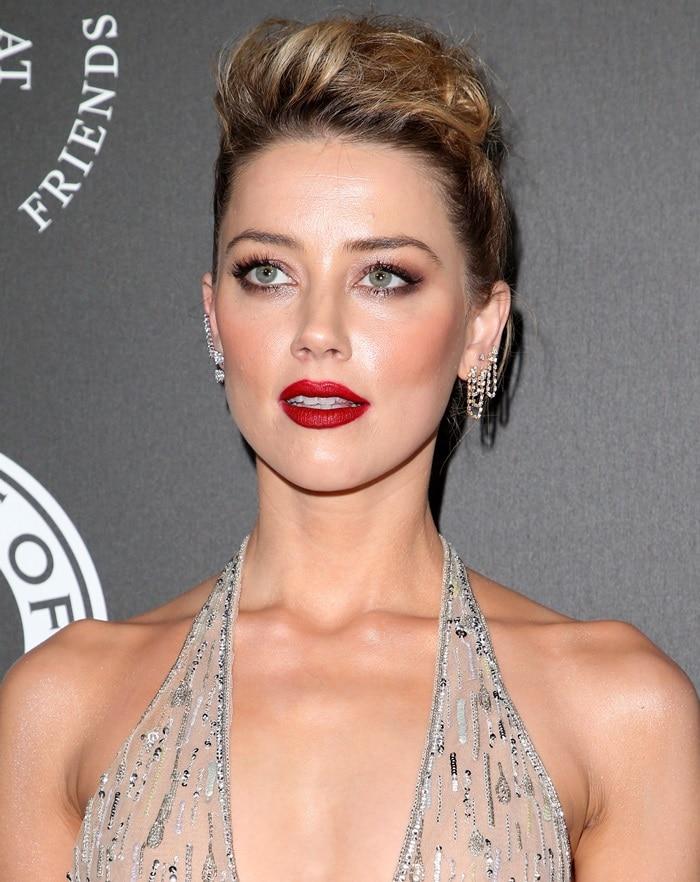 Amber Heard wearing mismatched earrings from Anita Ko