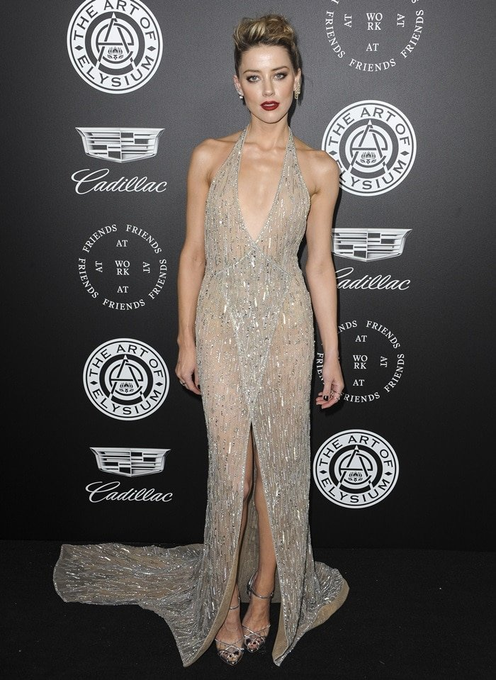 Amber Heard went super sexy in a silver tulle wrap dress, fully embroidered with silver threads, beads and crystals, from the Georges Hobeika Autumn Winter 2017/2018 Couture Collection