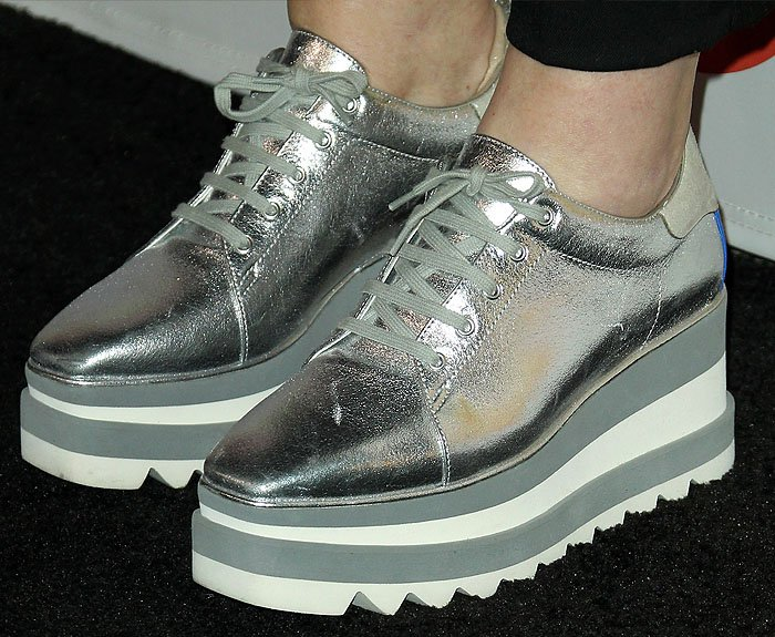 Details of Amy Poehler's Stella McCartney 'Sneak-Elyse' rubber-platform trainers in silver metallic.