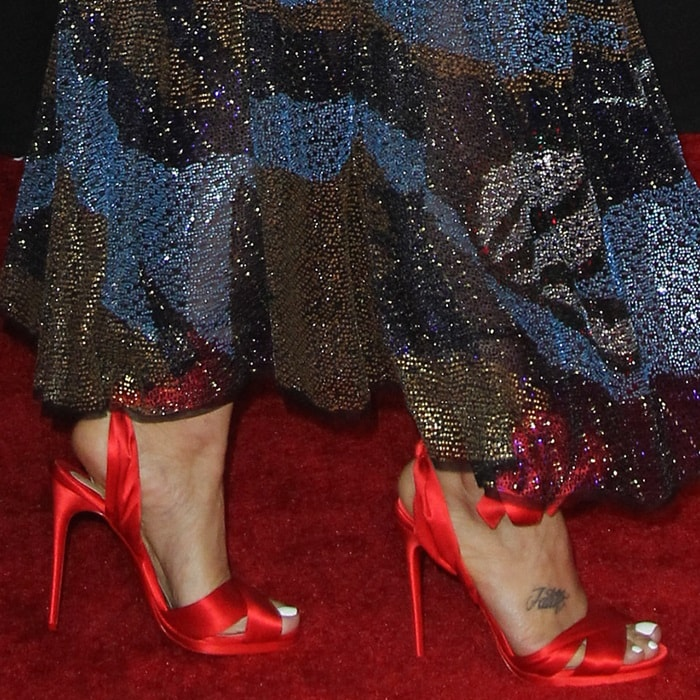 Andra Day wearing Christian Louboutin's scarf-inspired 'Tres Frais' satin sandals