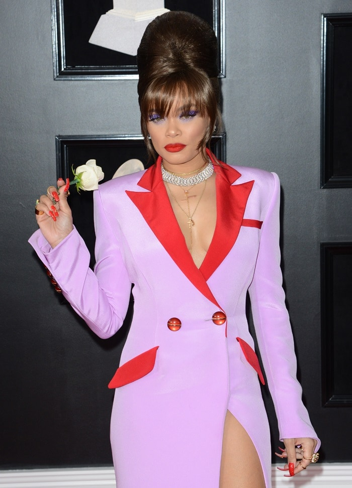 Andra Day wearing a purple and red trench coat dress from Victoria Hayes at the 2018 Grammy Awards held at Madison Square Garden in New York City on January 28, 2018