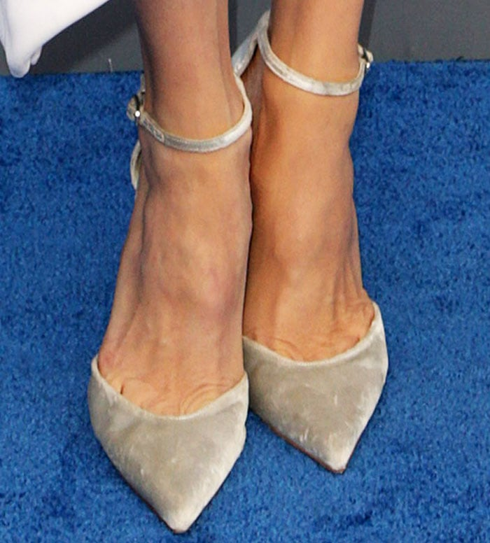 "Angelina opted to soften her look with a pair of velvet Stuart Weitzman ""Candy"" pumps"