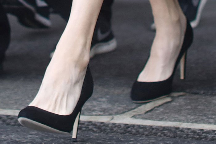 Closeup of the Giusepe Zanotti 'Annette' black suede pumps on Angelina Jolie.