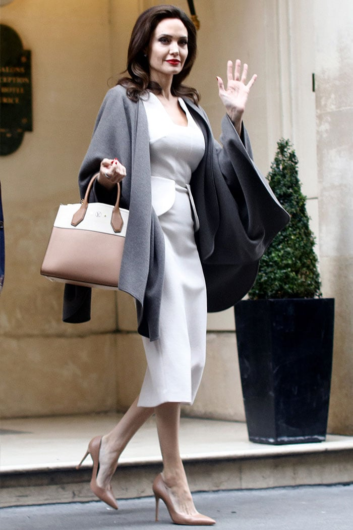 Angelina Jolie completed her look with a Louis Vuitton 'City Steamer' bag, which matched perfectly with her light tan Jimmy Choo 'Anouk' pointy-toe pumps