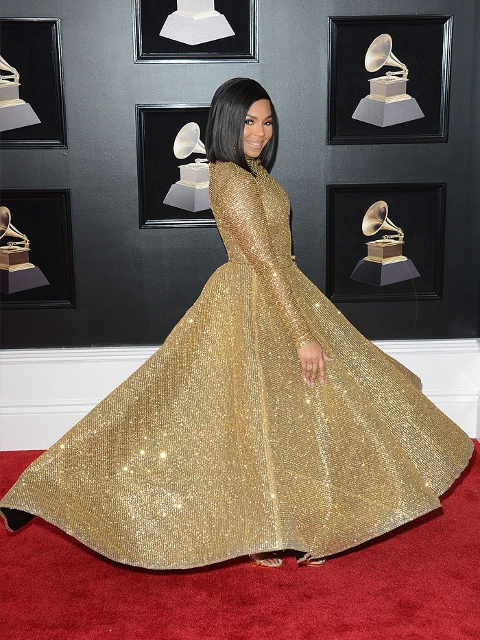 Ashanti's gold long-sleeved Yas Couture by Elie Madi gown