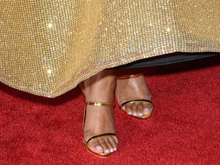 Ashanti's feet in gold Giuseppe Zanotti 'Harmony' triple-strap sandals