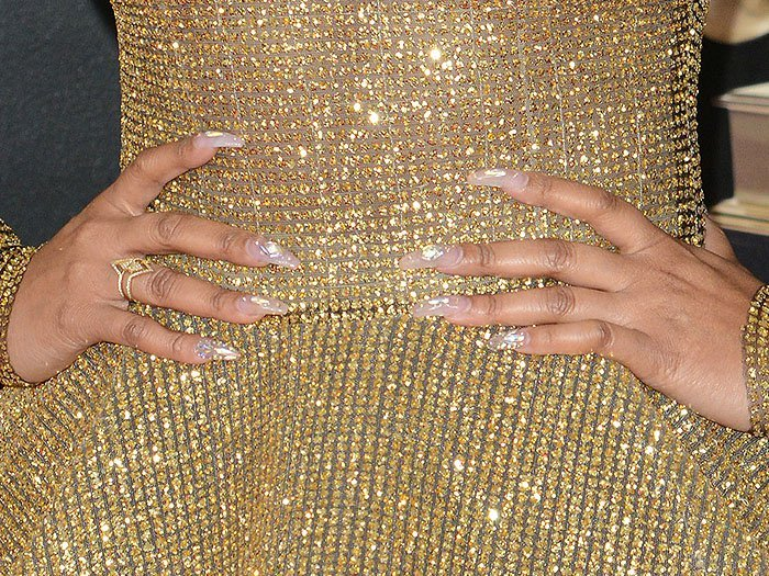 Details of Ashanti's opalescent, holographic nails