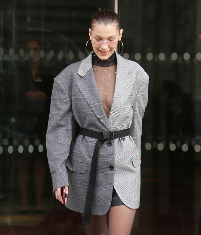 Braless Bella Hadid leaving Le Royal Monceau Raffles in an outfit from the Heron Preston Fall 2018 collection in Paris on January 17, 2018