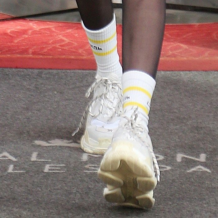 Bella Hadid showing off her colorblocked socks and Balenciaga 'Triple S' sneakers