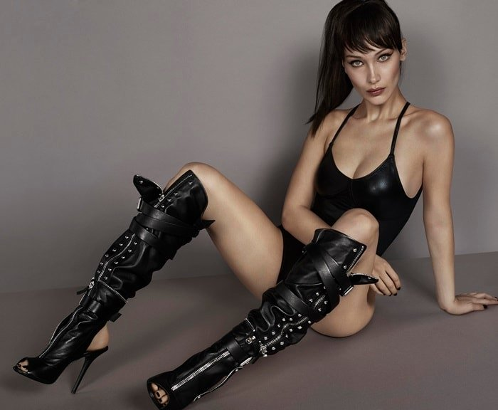 Bella Hadid wearing moto-inspired 'Kendra' cut-out booties with separate strap-on leather sheath