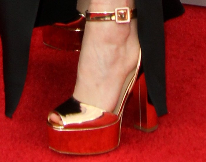 "Sarah added some glam to her look with the iconic gold Giuseppe Zanotti ""Lavinia"" sandals"