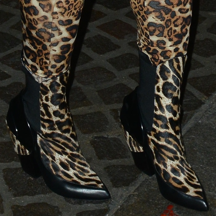 Blac Chyna wearing animal print ankle boots that matched the rest of her outfit