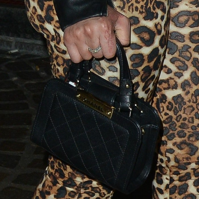 Blac Chyna toting a black Chanel bag