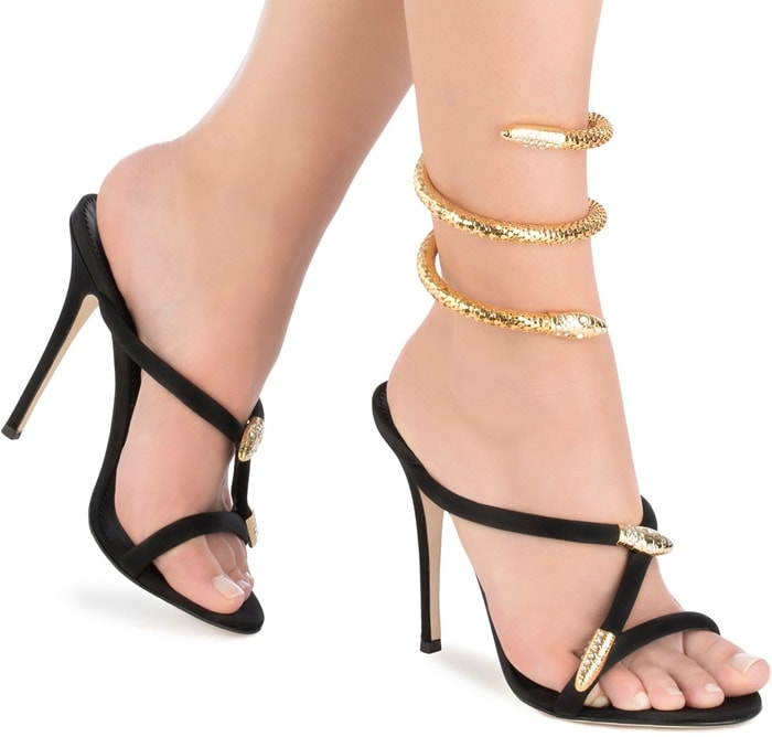 Sandals accented by gold-tone snake hardware encrusted with sparkling crystals