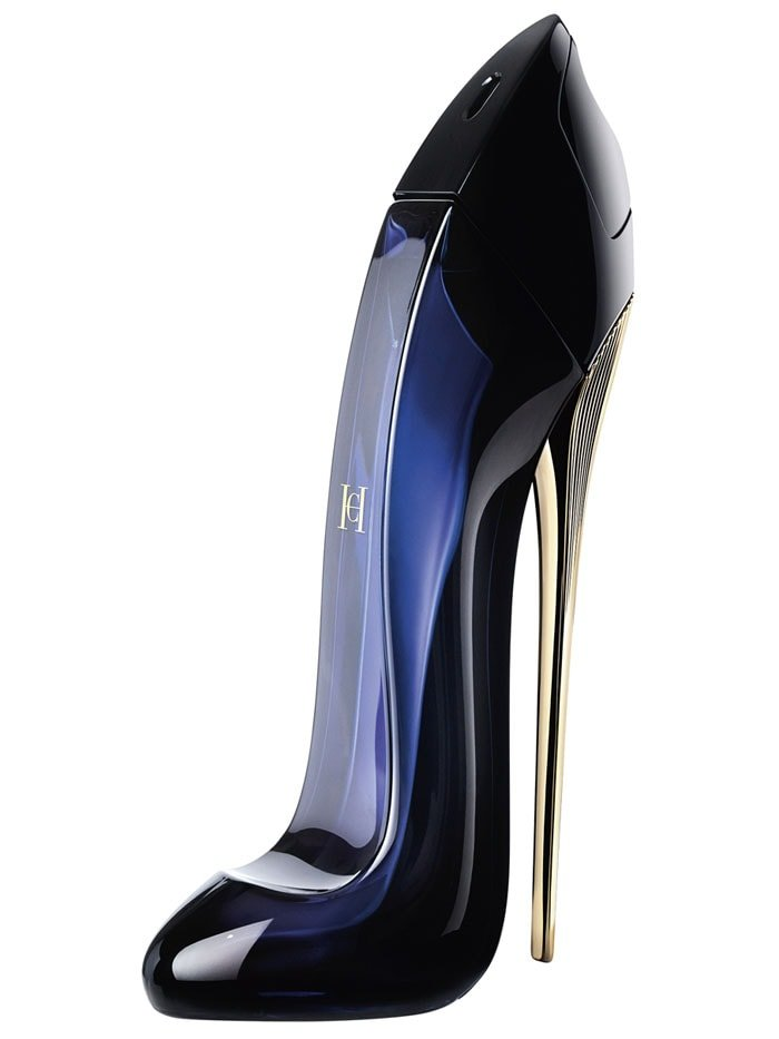 Carolina Herrera Good Girl fragrance in its shoe-shaped bottle standing on a gold stiletto heel.